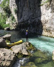 A young men celebrating the end of his sport tour in Croatia where you can do rafting in Omis.