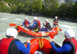 """Water is splashing on the happy participants of the Rafting """"Action"""" for Young & Old - Imster Schlucht with CanKick Ötztal."""