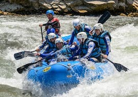 During the rafting tour for advanced people, offered by UR Pirineos, a group of friends paddles the wild rapids of Río Gállego.