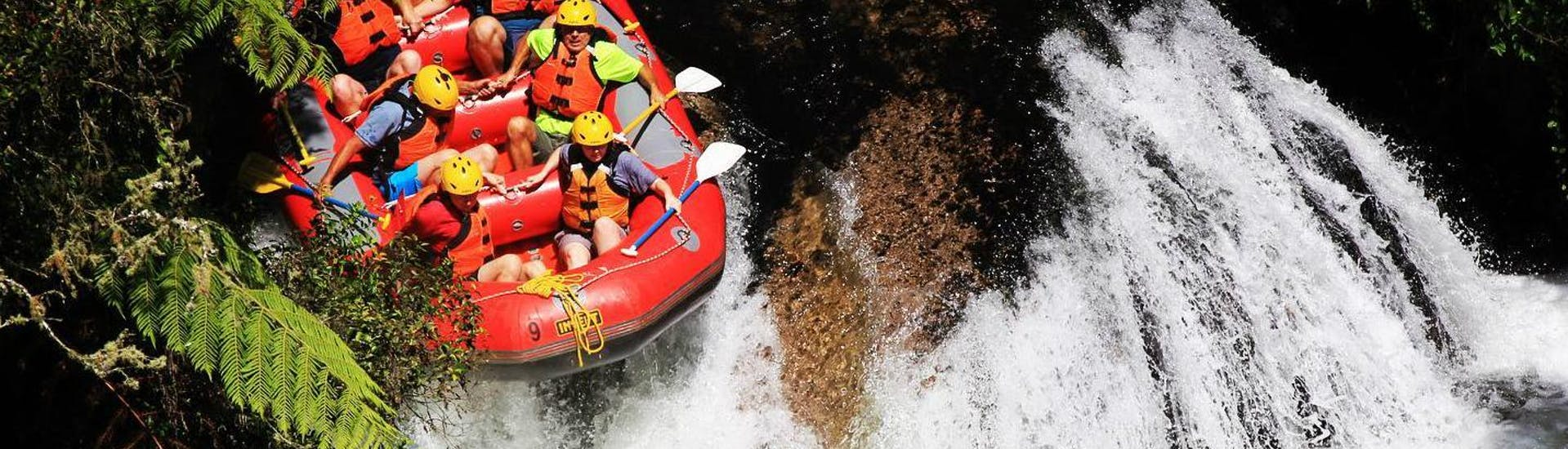 A group of rafters is taking the plunge at the famous Tutea Falls, worlds highest commercially rafted waterfall, during a tour with Rafting Adventure Rotorua.