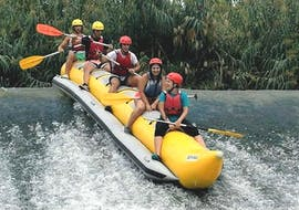"People are having fun whilst riding down a river during the Rafting ""Banana Boat"" - Rio Segura organised by Rafting Murcia."