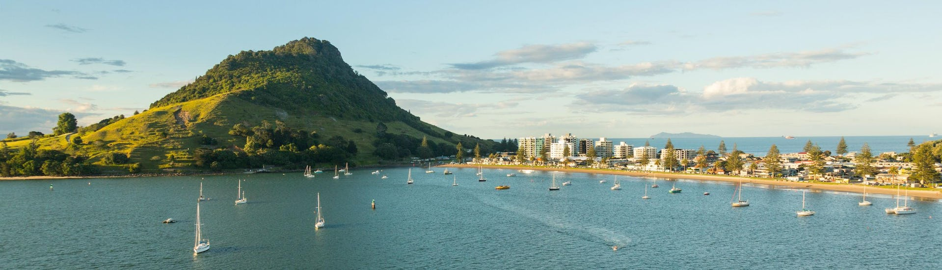 An image of Mount Maunganui in Tauranga, a city in the Bay of Plenty, where visitors can enjoy a range of rafting tours.