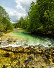An image of the Sava Bohinjka river, a popular place to go rafting near Bled.
