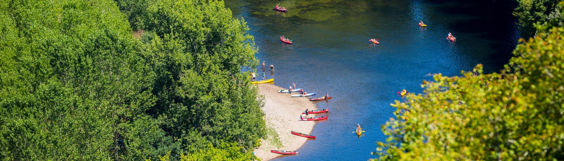 Aerial view of a meander of the Dordogne River near Domme in the Périgord, very popular among canoeing enthusiasts.