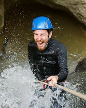A young man is seemigly having lots of fun canyoning in Greifenburg.