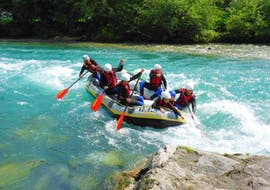 A group of rafters is navigating through a rapid on the Ziller river as a part of the Rafting & Canyoning Package - Blue Lagoon & Ziller organized by Freiluftakademie.