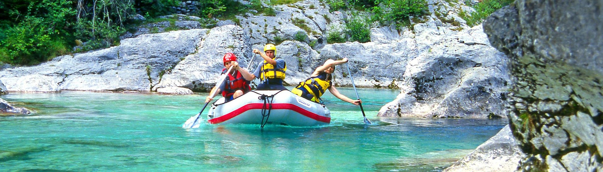 A group of young people enjoying some white water rafting fun in the rafting & canyoning hotspot of Sušec.