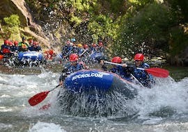 A group of friends is trying to master the Noguera Pallaresa River during their rafting tour provided by ROCROI.