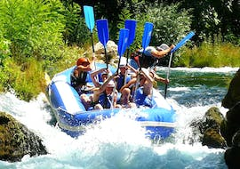 "A rafting group mastering the wild rapids of the Cetina River on their Rafting ""Classic"" Tour with an experienced instructor from Croatia Rafting."