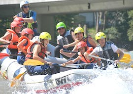 A group is having fun whilst participating in Rafting on the Enns River  organised by best adventure company Schladming.
