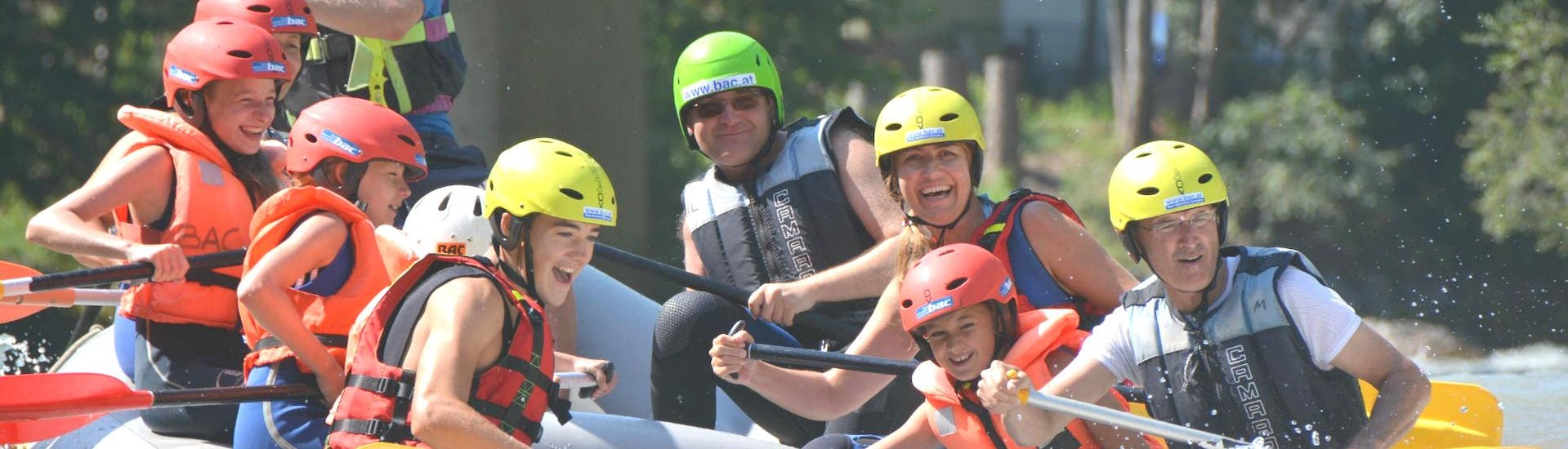"""A family is tackling cascades on a raft during the Rafting """"Classic"""" - Enns with the help of an experienced rafting guide from best adventure company."""