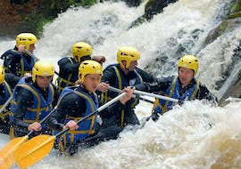 A group of friends is caught in rapids while Rafting on Le Chalaux River - Classic with AN Rafting Morvan.