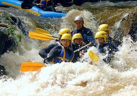 A group of friends is caught in rapids while Rafting on Le Chalaux River in Low Season - Classic with AN Rafting Morvan.