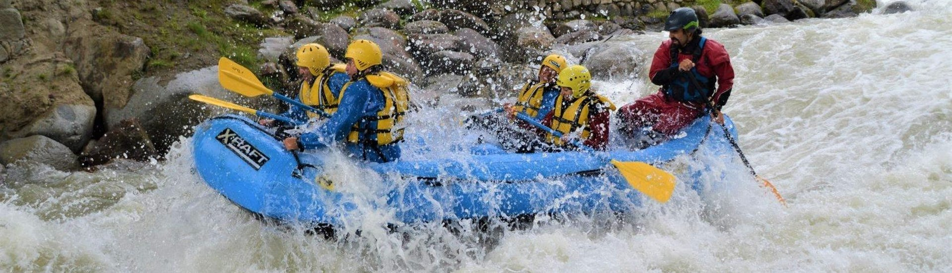The participants of the Rafting Colorado Slalom on the river Noce are conquering the rapids while having fun during the activity organized by X Raft val di Sole.