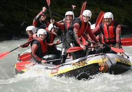 """A group of friends is having fun on a rafting boat during their Rafting """"Daytrip"""" - Inn with Cankick Ötztal."""