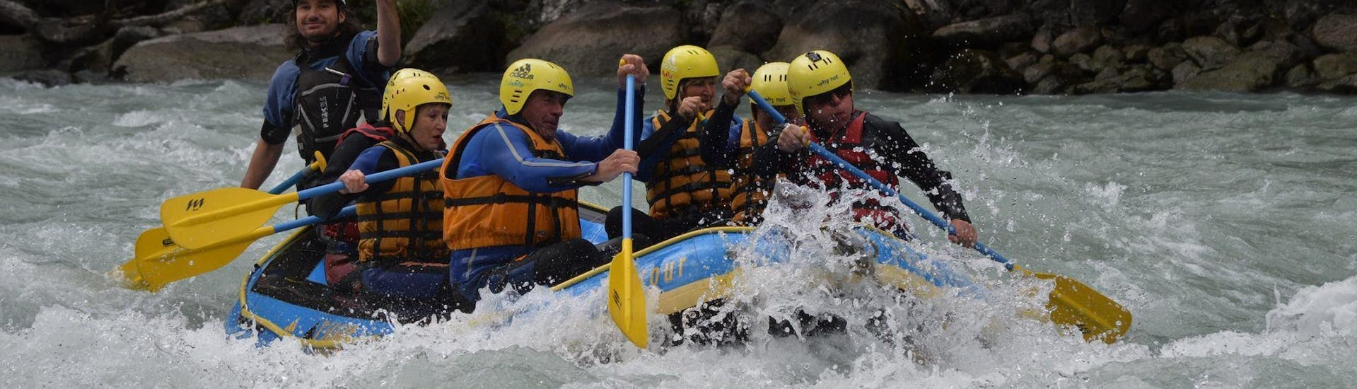 """During the rafting """"Extreme Tour"""" through Landeck Canyon, a group of rafting enthusiasts is concentrating on paddling through rapids with a certified rafting guide from WhyNot Adventures."""