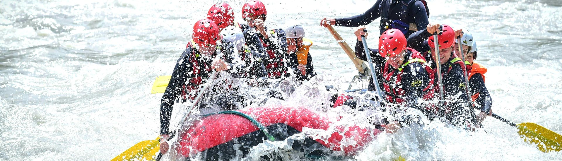 "A rafting group mastering the wild waves and rollers of Ötztaler Ache on their Rafting Tour ""Extreme"" with Experience together with two state-certified guides from Natur Pur Outdoorsports."