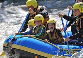 """During the Rafting """"Family Tour"""" on Upper Inn, a family is having fun whilst going through some rapids with a certified rafting guide from WhyNot Adventures."""