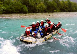A group of rafters is paddling along the river during their Rafting for Adventurers on the Ziller with Freiluftakademie.