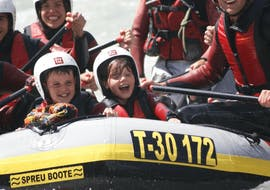 Two kids are having fun in a rafting boat during the Rafting for Families - Inn with CanKick Ötztal.