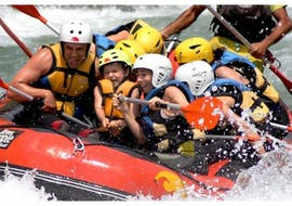 A group of kids have fun while rafting on the Rio Esera with Sin Fronteras Adventure.