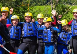 A large family is seemingly excited about their activity Rafting for Families - Ziller with Mountain Sports Mayrhofen.