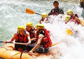 A group of friends is crossing rapids during their Rafting on the Dranse River - Full Descent tour with Evolution 2 Aquarafting Lake Geneva.