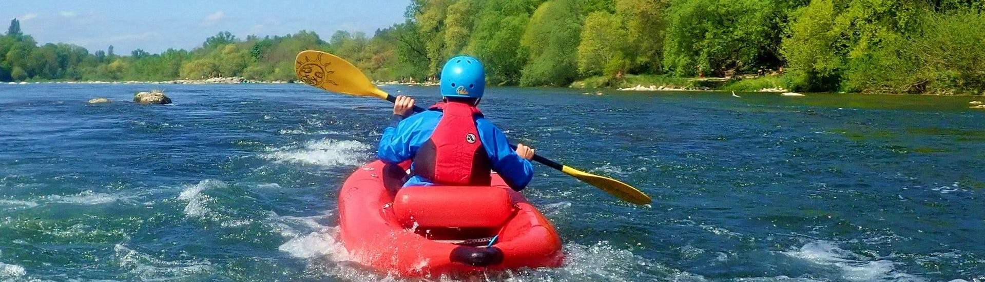 During the Rafting in a FUNYak on the Rhine - Flowing Rhine with Rheinraft, a participant is paddling along the beautiful Rhine river.