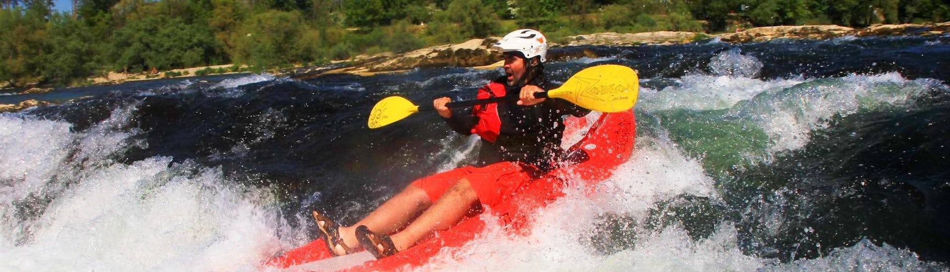 During the Rafting in a FUNYak on the Rhine - Wild Rhine with Rheinraft, a participant conquers a rapid in his agile, inflatable kayak.