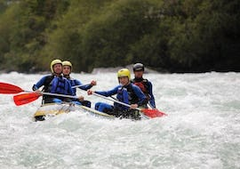 "A group of people participating in the tour Rafting in ""Mini Rafts"" for Explorers - Ziller with Mountain Sports Mayrhofen is navigating their raft along the rousing rapids of the river."