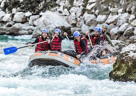 """The participants of the Actionrafting with """"Minirafts"""" - Saalach offered by Base Camp, are paddling through a rapid on Saalach river near Lofer."""