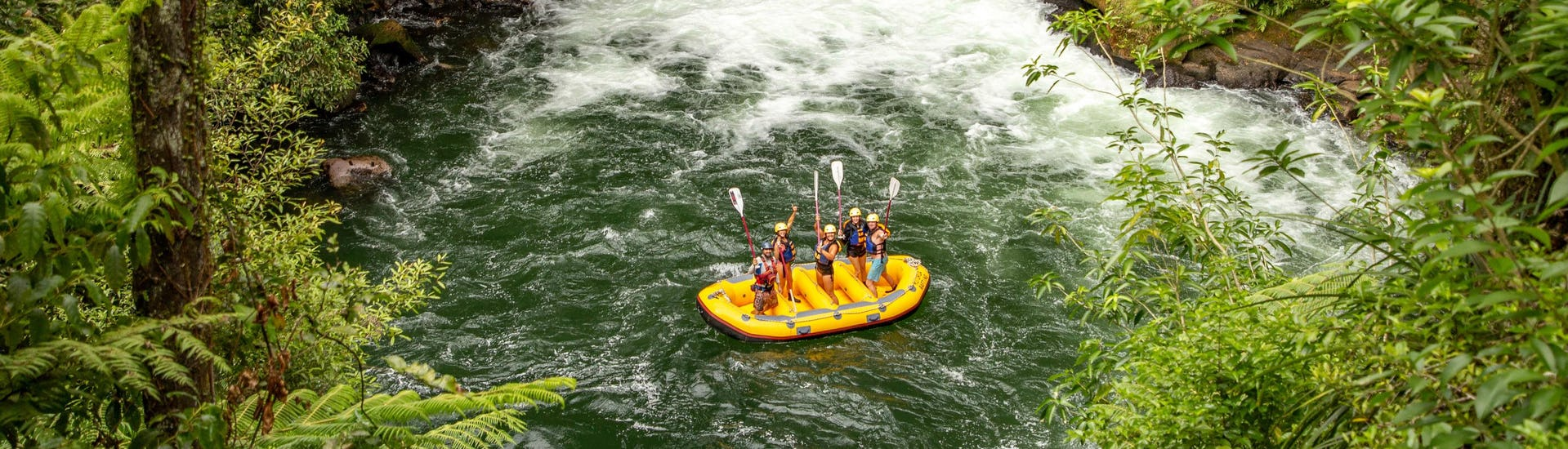 The participants of Rafting on Kaituna River - Winter are celebrating that they just mastered the plunge over Tutea Falls, the world's highest commercially rafted waterfall, together with their professional guides from Rotorua Rafting.