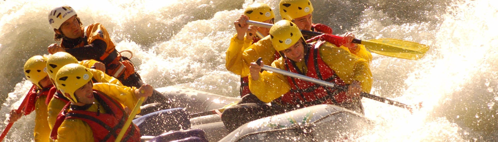 Some participants of the Rafting on the Dora Baltea - Advanced organized by Rafting Republic are mastering the river during the activity on the river Dora Baltea.