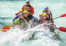 A group of participants of the Rafting on the Dora Baltea - Classic organized by Rafting Republic are paddling down the river during an exciting ride.