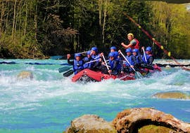 During their Half Day Rafting Tour on the Lech River with Fun Rafting Lechtal, the participants paddle over the splashing rapids of the Lech river.