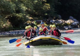 """A family is having fun on the river during their Rafting """"Panorama"""" for Kids and Families - Saalach organized by Base Camp."""