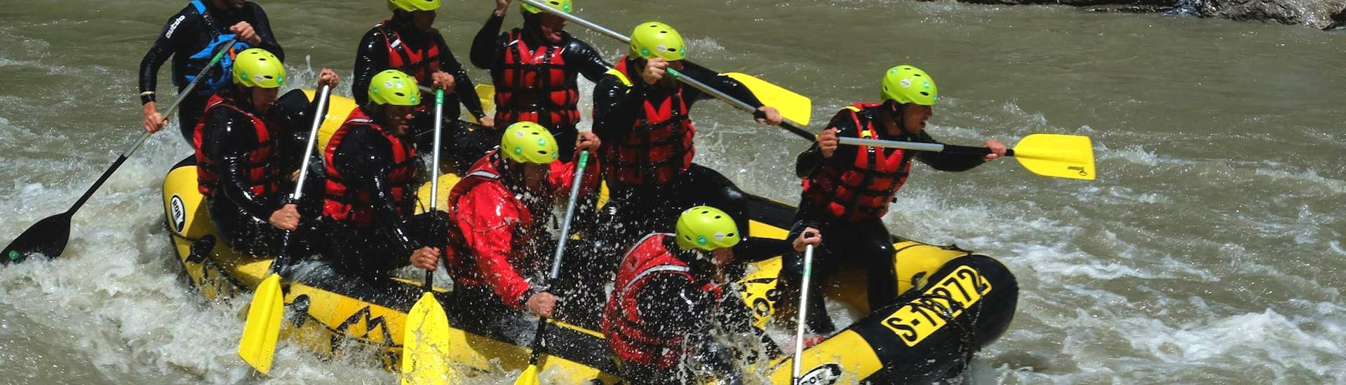 A group of people proving full team spirit on their Rafting Tour with a Private Boat VIP on the Salzach with Frost Rafting & Canyoning Tours.