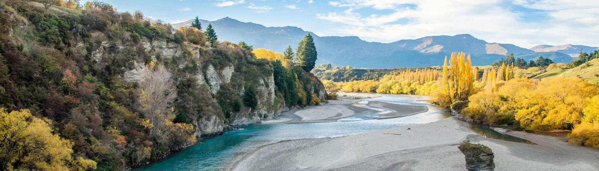 A view of the beautiful Shotover River that visitors paddle along when rafting in Queenstown.