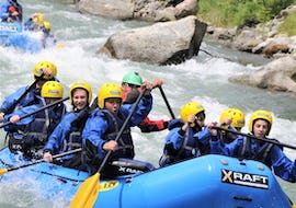 Some friends are enjoying the rafting descent Rafting Rio Claro on the river Noce organized by X Raft Val di Sole.