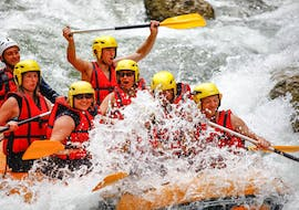 A group of friends is crossing rapids during their Rafting on the Dranse River - Rodeo tour with Evolution 2 Aquarafting Lake Geneva.