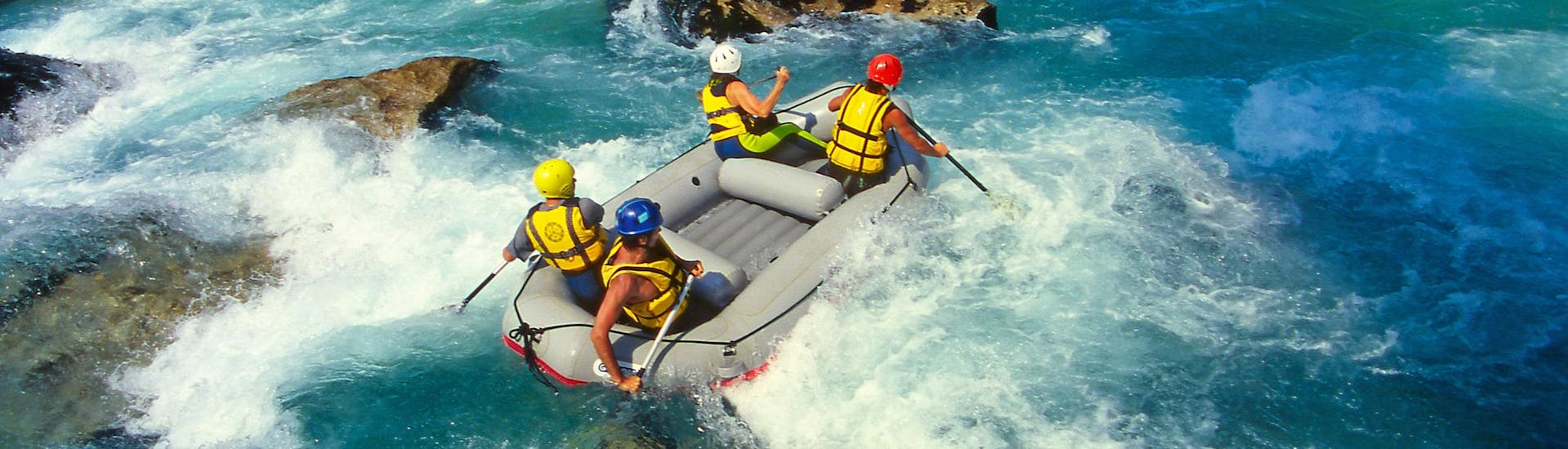 A group of friends having fun on a white water rafting tour in the rafting hotspot of Dronne River.