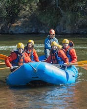 A group of people is enjoying themselves while rafting in Serre-Chevalier.