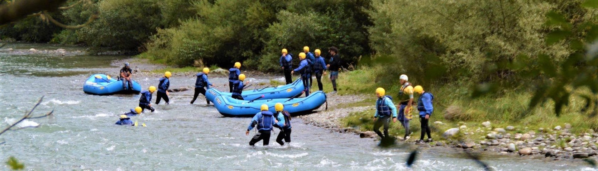 The participants of the Rafting Super integral on the river Noce organized by X Raft Val di Sole are going out from the river at the end of the activity.