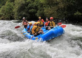 The participants of Rangitaiki River Rafting in Murupara with Rafting Adventure Rotorua are facing a rapid on the river.