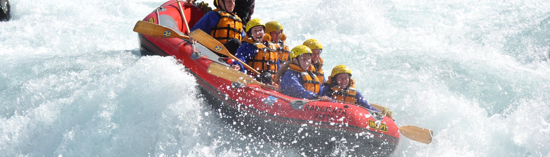 The participants of Rangitata Gorge Rafting with Christchurch transfer organized by Rangitata Rafts are facing a thunderous grade 5 rapid on the river.