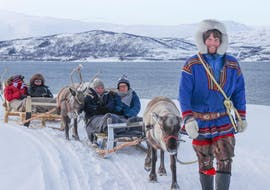 A reindeer herder is taking a group of tourists for the Reindeer Sledding in Tromsø & Sami Culture - 15 min organised by the Tromso Arctic Reindeer.