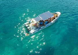 One of the boats from Vie  del Mediterraneo is making its way across the blue waters during the rib boat trip from Porto Cesareo to Punta Prosciutto.