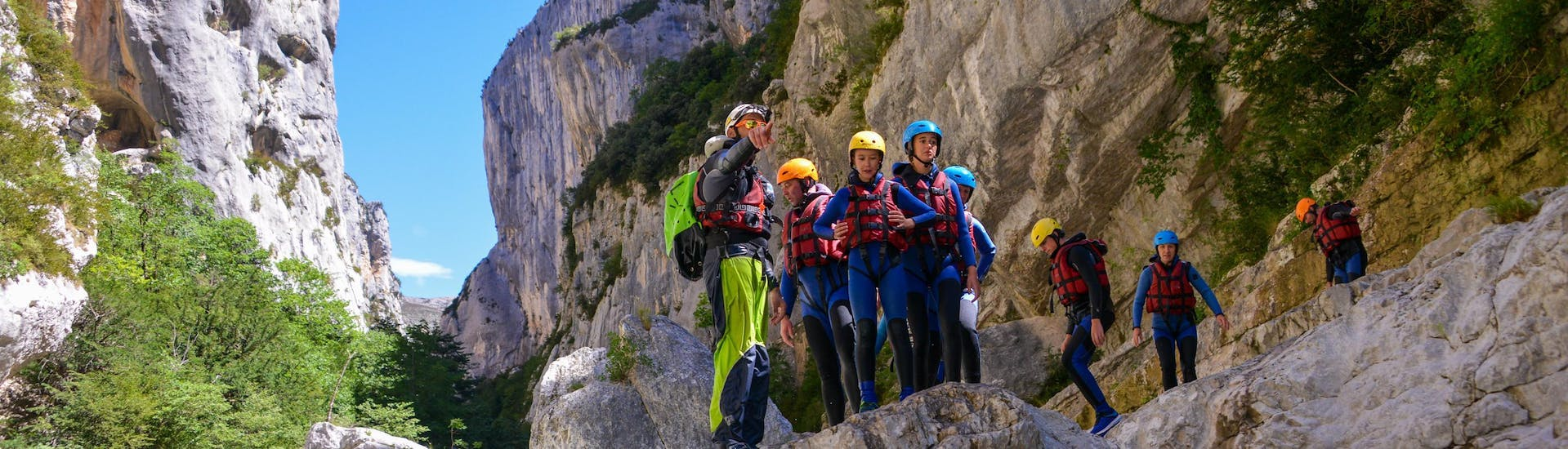 """A group of children is getting ready to jump in the emerald waters of the Gorges du Verdon during their river trekking tour """"Couloir Samson"""" with Yeti Rafting during the low season."""