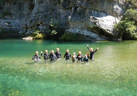 "A group of people are following their guide during their canyoning river trekking ""fun"" in the Canyon Pas de Soucy with B&ABA Sport Nature."
