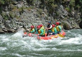 The tour participants pass a beautiful stone wall and fight their way through the rapids during the rotorua rafting scenic trip - rangitaiki river with River Rats Rotorua Raft & Kayak.